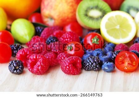 ripe wild fruits on table - stock photo
