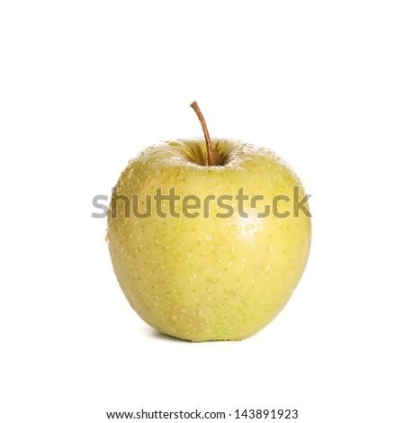 ripe yellow apple on white - stock photo