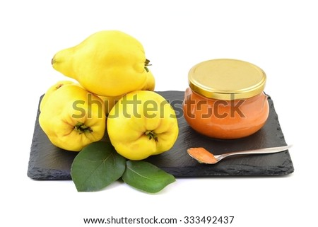 Ripe yellow quinces and quince jam.  - stock photo