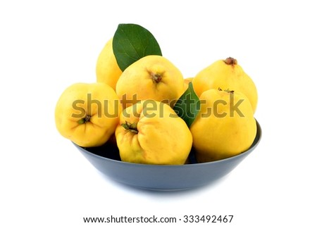 Ripe yellow quinces isolated on white background. - stock photo
