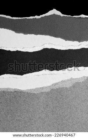 Ripped black, white and grey papers - stock photo