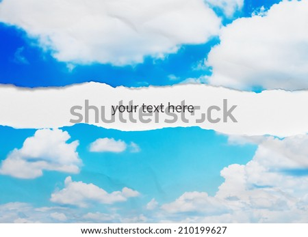 Ripped paper, sky background - stock photo