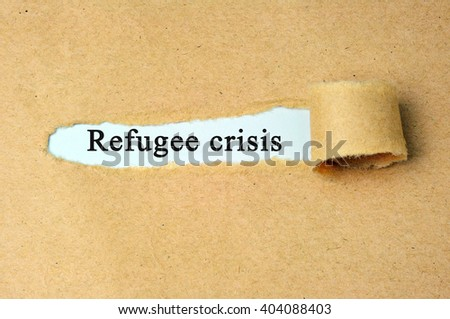 """Ripped paper with  """"refugee crisis"""" text.  - stock photo"""