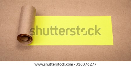 Ripped paper with space for text with yellow background - stock photo