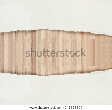 Ripped white paper texture and wooden texture background. - stock photo