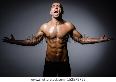 Ripped young man in bodybuilding concept - stock photo