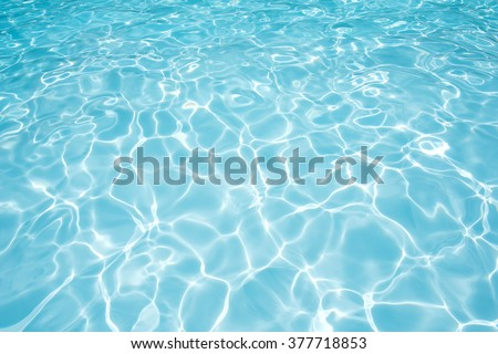 Ripple water surface and sun reflection in swimming pool - stock photo