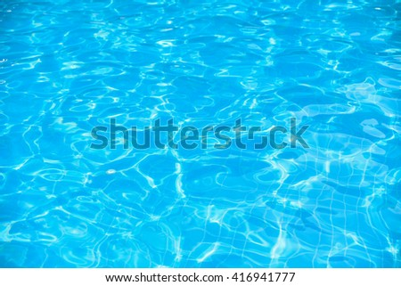 Ripple water surface in swimming pool - stock photo