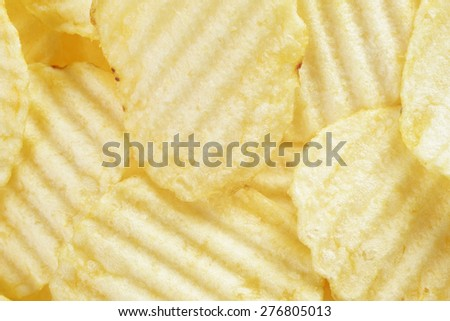 rippled organic potato chips with salt - stock photo