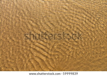 ripples in shallow water over a sand bank - stock photo