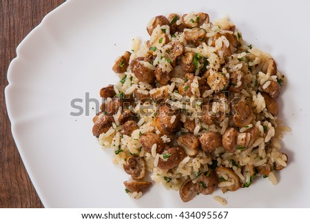 rise with mushrooms on plate - stock photo