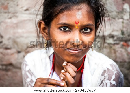 Rishikesh, India - 23 September 2014: The portrait of smiling indian girl on the street on 23 September 2014 in Rishikesh, India. - stock photo