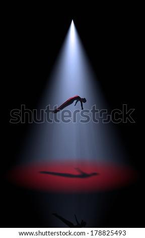 rising body in the spotlight - stock photo