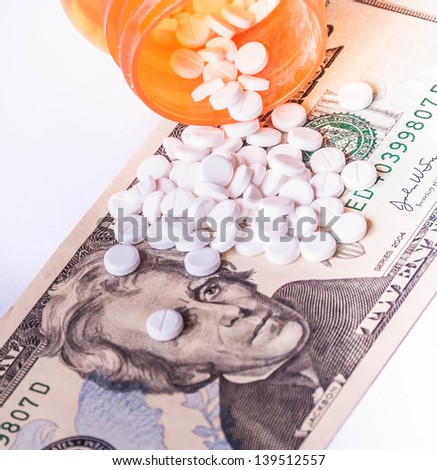 Rising cost of health care with spilled medicine. Drug abuse. Addiction. - stock photo