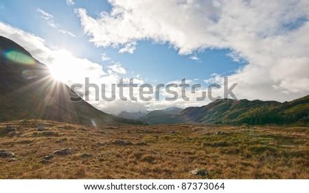 Rising Sun on a Glen next to Fort William, Scotland - stock photo