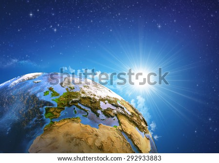 Rising sun over the Earth and its landforms, view of Europe, North Africa and Middle East. Elements of this image furnished by NASA - stock photo