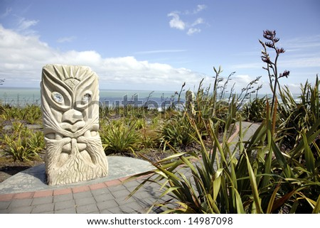 Rising Sun Tawhiri, Maori God of Wind and Storm, Raglan, New Zealand - stock photo
