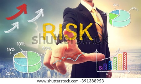 Risk concept with businessman and graphs and arrows - stock photo
