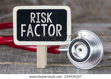 Risk factor and stethoscope. Medecine concept. Blackboard with word risk factor and stethoscope - stock photo