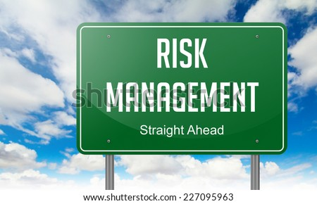 Risk Management - Highway Signpost on Sky Background. - stock photo