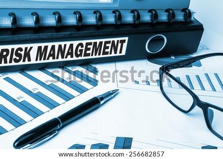 risk management label on business document folder - stock photo