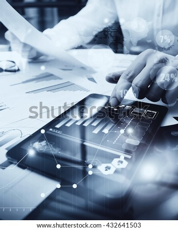 Risk Management Work process.Picture Trader working Market Report Document Touching Screen Tablet.Using Worldwide Graphic Icons,Stock Exchange Reports.Business Project Startup.Vertical,black white - stock photo