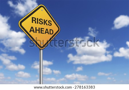 risks ahead road sign and blue sky - stock photo