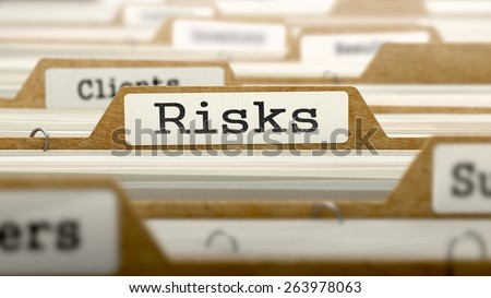 Risks Concept. Word on Folder Register of Card Index. Selective Focus. - stock photo