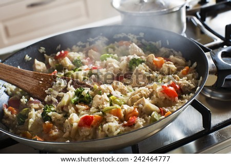 Risotto cooking on the stove close-up - stock photo