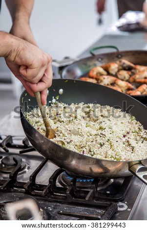 Risotto in a pan being cooked in a restaurant - stock photo