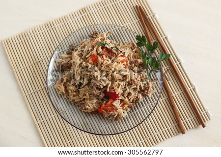 risotto on a mat with chopsticks rice - stock photo