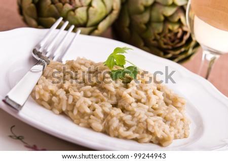 Risotto with artichokes. - stock photo