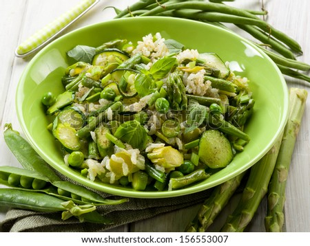 risotto with asparagus zucchinis and green beans,vegetarian food - stock photo