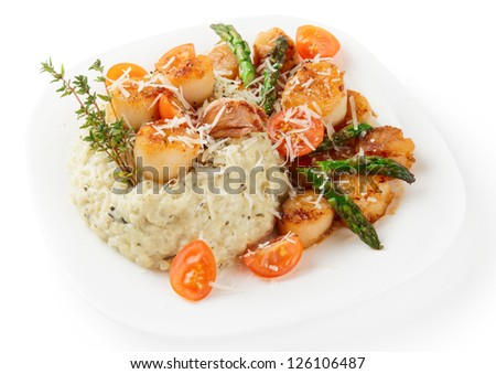 Risotto with pan seared sea scallops, cheese and vegetables  isolated on white background - stock photo