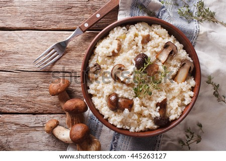 risotto with porcini mushrooms and thyme close-up on the plate. horizontal view from above  - stock photo