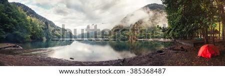 Ritsa lake tent camping - stock photo