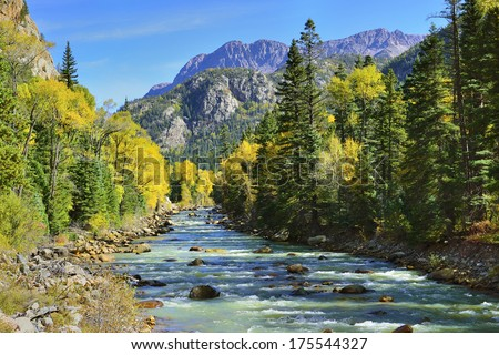 river and colourful mountains of Colorado during foliage season - stock photo