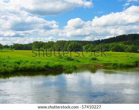 River and green meadow - stock photo