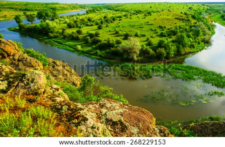 river and vegetation in rural areas, the spring season - stock photo