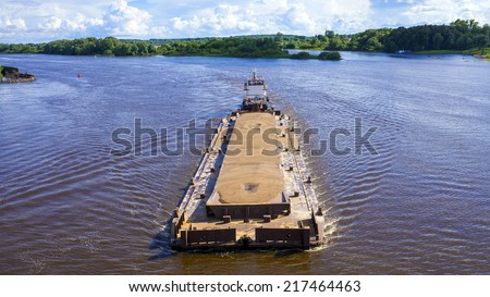 river barge loaded with sand - stock photo