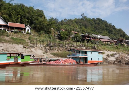 River barges on Mekongu in Laos - stock photo
