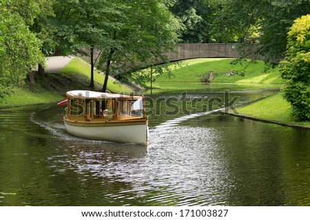 River boat on a cruise in Riga, Latvia on a sunny summer day. - stock photo