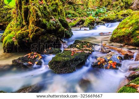 River cascade in a forest in Transylvania mountains-Romania - stock photo