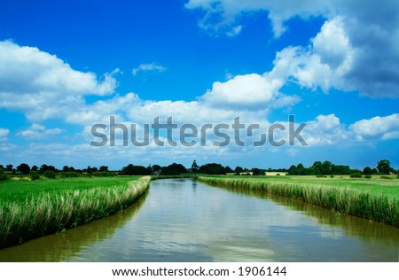River cruise in Norfolk broads, England - stock photo