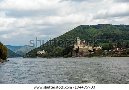 River Danube view of Schonbuhel Castle, and a monastery in the background, in the Wachau Valley near Melk, Austria - stock photo