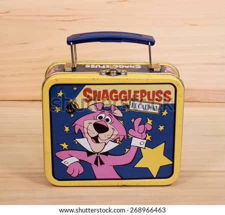 RIVER FALLS,WISCONSIN-APRIL 12,2015: A vintage Snagglepuss metal lunch box. Snagglepuss was a cartoon character created by Hanna- Barbera in Nineteen Fifty Nine. - stock photo