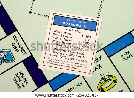RIVER FALLS,WISCONSIN-FEBRUARY 22,2015: Closeup view of a Monopoly board featuring the Boardwalk card. - stock photo