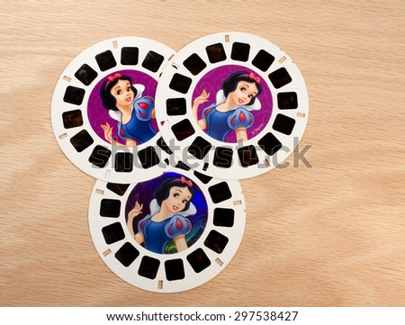 RIVER FALLS,WISCONSIN-JULY 17,2015: Three vintage Snow White and the Seven Dwarfs View-Master disks. Walt Disney made a movie based on this story in Nineteen Thirty Seven. - stock photo