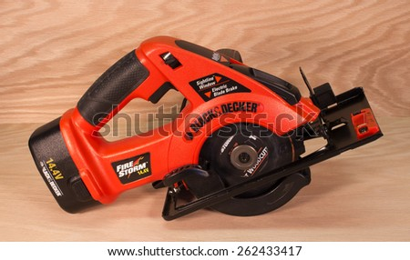 RIVER FALLS,WISCONSIN-MARCH 21,2015: A Fire Storm battery operated circular saw by Black and Decker. - stock photo