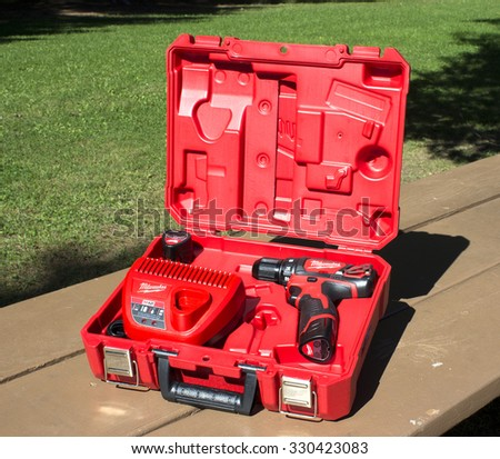 RIVER FALLS,WISCONSIN-OCTOBER 21,2015: A Milwaukee cordless drill in a case with battery and charger. - stock photo